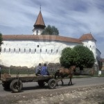 Romania, Transylvania, Prejmer, Saxon fortified church and horse-drawn cart.  UNESCO World Heritage